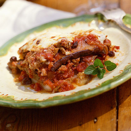 Lamb Moussaka RecipeThis hearty comfort dish is reminiscent of lasagna, layering eggplant, ground lamb or beef, and creamy white sauce–all baked to perfection.
