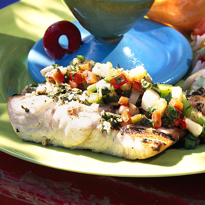 Montego Bay Grilled Fish with Caribbean Salsa RecipeGrill a firm fish spiced with cilantro, jalapeño, and lime juice, then top with a festive Caribbean salsa. Packed with chopped banana, bell pepper, cilantro, and brown sugar, the spicy-sweet salsa is the perfect foil to the smoky filet.