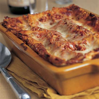 Tomato-Basil Lasagna with Prosciutto RecipeLower-fat cheeses cut the calories in this rich lasagna, which boasts merely 272 per serving.