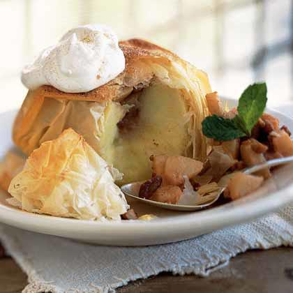 Apples Baked in Phyllo with Pear-and-Pecan Filling RecipeFor a fun spin on the traditional apple pie, stuff Granny Smith apples with a spiced pear and pecan mixture and bake in phyllo dough.