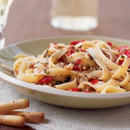 Clam Sauce RecipeThis quick-and-easy clam sauce recipe features canned clams, chopped tomatoes, minced garlic, white wine, crushed red pepper, and fresh herbs. Serve over hot cooked fettuccine for an easy weeknight entrée.
