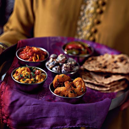 Dine in traditional Indian fashion by serving the meal in thali style. Indian meals are often served thali style. A variety of dishes are placed in small bowls and served from a large round plate. Try this shrimp curry main dish as part of a thali meal or serve alongside a spiced rice pilaf. Recipe: Madras Shrimp Molahu Veritadu Curry in Black Pepper Sauce