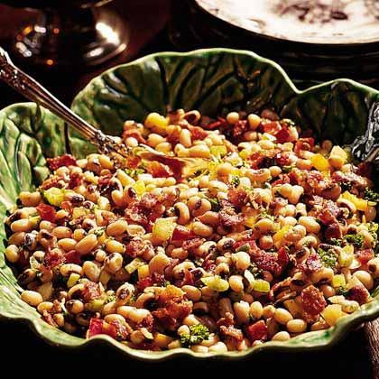 Hoppin' John Salad RecipeHoppin' John, a mixture of black-eyed peas, rice, bacon and red peppers, is eaten by Southerners to bring luck for the New Year. Even if it's not New Year's Day, family and friends will be lucky to eat such a tasty Southern staple.