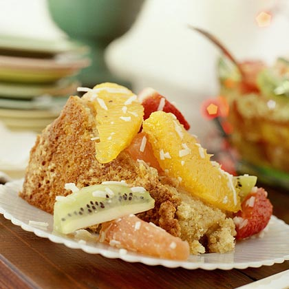 Ambrosia RecipeBreeze through dessert by picking up a few key ingredients ahead of time. Purchase a pound cake from your local supermarket, then jazz it up with toppings, sauces, and drizzles. This fruit-filled ambrosia, spiked with sweetened coconut and dark rum, makes for a colorful—and tasty—cake topper.