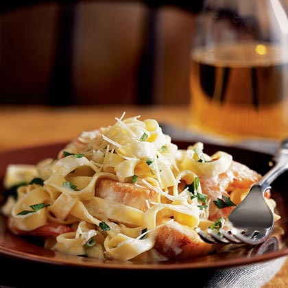 Seafood Fettuccine RecipeThis delicious seafood pasta features a homemade alfredo sauce and fresh shrimp, sea scallops, and crab.