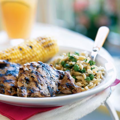 For a healthier alternative to traditional fried chicken, try this simple grilled dish.Chicken Thighs with Thyme and Lemon Recipe