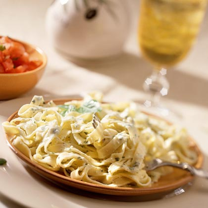Fettuccine with Creamy Basil-Pine Nut Sauce RecipeCreamy sauces don't have to rely on whipping cream for their silky texture. Here, nonfat yogurt and light ricotta join forces to create a smooth, basil-scented pasta sauce with only 26 percent of calories from fat.