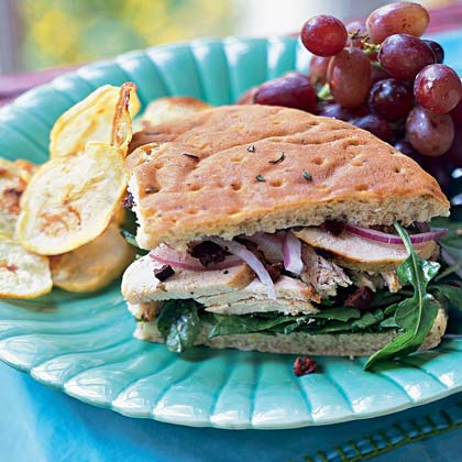 Chicken-Arugula Focaccia Sandwiches                            RecipeServe Mediterranean Grilled Chicken for a weeknight dinner and revive the leftovers into this easy-to-pack sandwich. The spices have time to mellow overnight and are fantastic when paired with crisp arugula and rosemary focaccia bread.