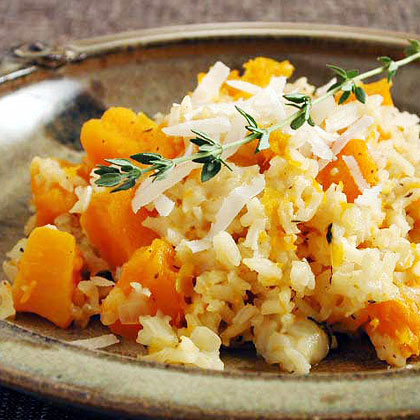 Baked Rice with Butternut Squash RecipeFor a casserole-style dish that is sure to be a hit during the holidays, you can't go wrong with savory rice and squash recipe. It's full of flavor from the tender butternut squash and combination of herbs and cheese.