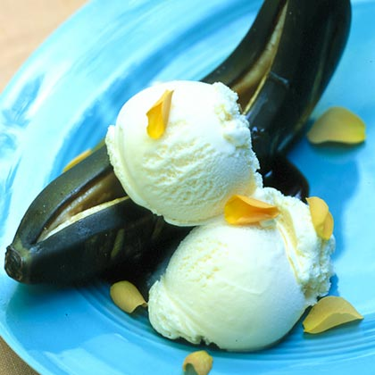 Dr. Bosker's Boogie-Woogie Brown-Sugared Barbecued Bananas RecipeFor a fun dessert that's out of the ordinary, grill bananas with brown sugar and orange liqueur. Top with ice cream and you'll have an easy dish that guests will love.