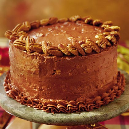 Chocolate Italian Cake RecipeThis is a chocolate version of the traditional Italian cream cake with coconuts and pecans folded into the batter and a rich, thick chocolate cream cheese filling and frosting.