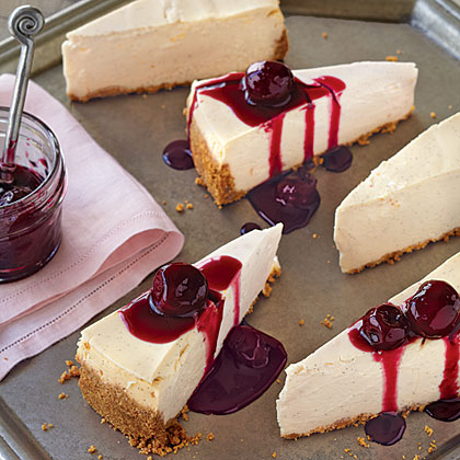Vanilla Cheesecake with Cherry Topping RecipeUsing fat-free cream cheese and fat-free sour cream in the batter and decreasing the amount of butter in the crust helps keep the fat content down in this holiday cheesecake. The rich flavor comes from fresh vanilla bean seeds and red wine-simmered cherries.
