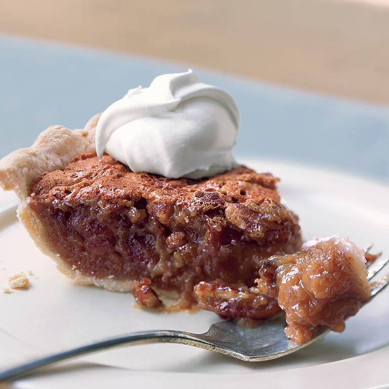 Pecan and Date Pie RecipeThe unexpected addition of dates to this classic pie gives the filling more body and a smooth sweetness. Don't use packaged chopped dates, which are rolled in sugar. Instead, use moist and sticky whole dates. Coat your knife with cooking spray for easy chopping