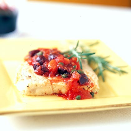 Olive Oil-Poached Mahimahi with Mediterranean Tomato Sauce RecipeTomatoes, olive oil, and rosemary are the perfect combo to spice up this tender white fish.