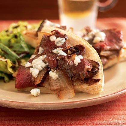 Steak and Blue Cheese Pizza RecipeBlue cheese crumbles and a creamy horseradish spread highlight the meaty slices of sirloin. Keep the steak tender by adding it towards the end of the 6-minute bake time. Get Holley's Recipe Tips