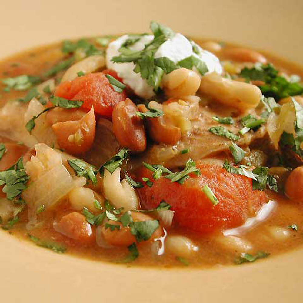 Combine chicken thighs with beans, tomatoes and green chiles for a hearty slow-cooker stew.Peasant Stew Recipe