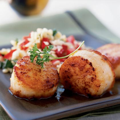 These sea scallops are crisp and glazed outside, then seared to keep tender and moist inside. For a simple meal, serve with orzo tossed with chopped tomato, feta cheese, basil, salt, and black pepper.Watch the VideoSimple Seared Scallops Recipe