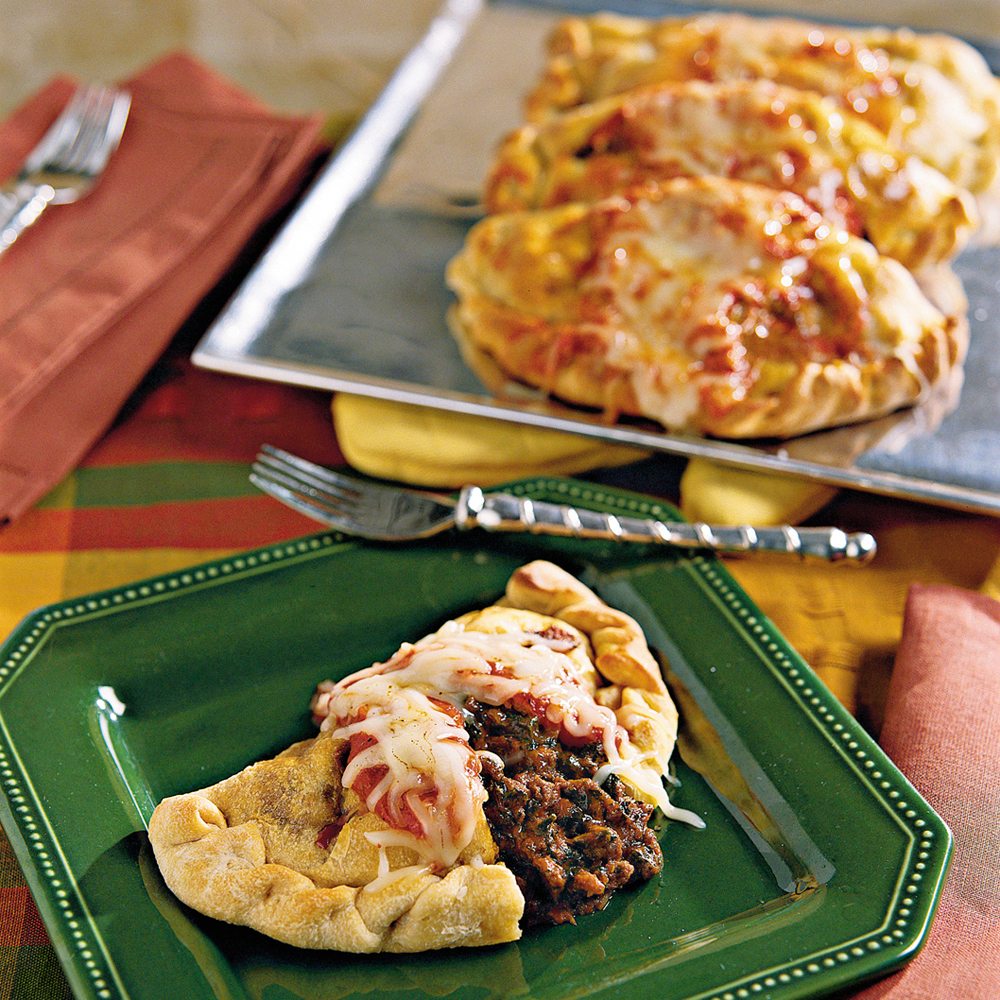Calzones with Italian Tomato Sauce RecipeMake your own portable dinner pockets by stuffing refrigerated pizza crust with ground beef, cheese, spinach, tomato and Italian seasonings. This meaty pizza-inspired favorite is great for on-the-go meals, or a fun family night in.