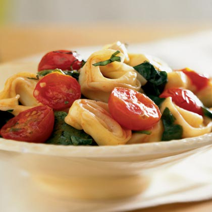 Tortellini with Spinach and Cherry Tomatoes RecipeUse any flavored tortellini or ravioli in this recipe. Spinach and cherry tomatoes add color, flavor and nutrition to this simple pasta dish.