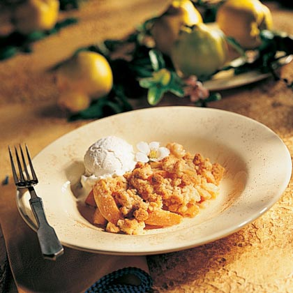 Quince-Apple Crisp RecipeThe tart quince, a seasonal fruit available between October and December, tastes like a cross between an apple and a pear. Its firm texture makes it a great addition to this classic six-ingredient apple crisp.