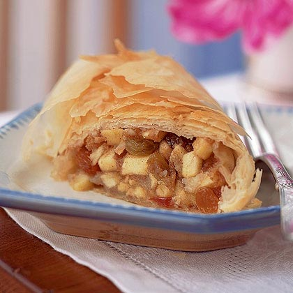 Apple Strudel RecipeWhy mess with old-fashioned pastry dough when you can make an easier and healthier strudel with sheets of phyllo dough? Even better, the filling is super simple to make with just six ingredients: apples, butter, sugar, golden raisins and cinnamon.