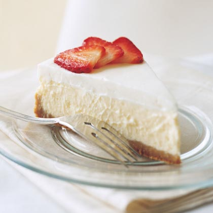 Cheesecake Cloud with Berries RecipeTop each elegant slice of this cheesecake with your favorite seasonal fruit for a classic, flavorful presentation.