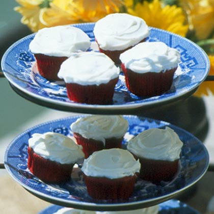 Easy Red Velvet Cupcakes RecipeUpdate the classic recipe with a few of our favorite shortcuts. Start with boxed cake mix and add a few tablespoons of cocoa. The red food coloring is optional, but adds great contrast between the cake and the frosting. Serve in muffin cups, or unwrap for pretty presentation.