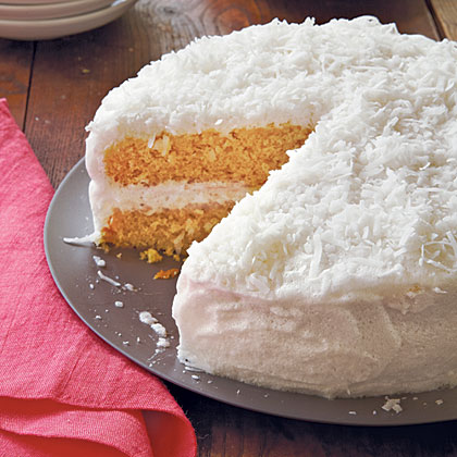 Double-Coconut Cake RecipeThis classic holiday cake is lower in fat than a traditional coconut cake because the frosting is made with egg whites instead of cream cheese and butter. And although real butter is used in the cake batter, it's only 1/3 cup because light coconut milk is added to help make the dessert rich and moist.