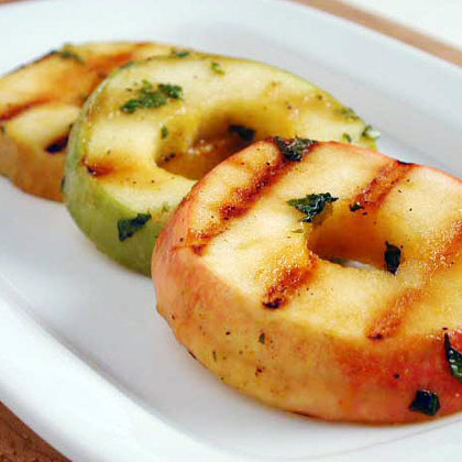 Marinated Grilled Apples with Mint RecipeSweetened with orange juice and honey, these juicy apples do double duty as both a side dish and dessert.