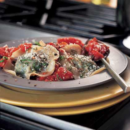 Spinach Ravioli with Tomato Sauce RecipeThis is an easy recipe to divvy up: The boss gets the fun part of making the ravioli while the sous-chef stands guard over the sauce.