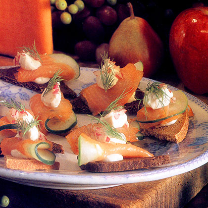 """Smoked Salmon Canapés Recipe""""I love these buttery canapés because you can make the dough ahead and top it with just about anything that appeals to you: a tapenade, sour cream and caviar, or Stilton and sautéed mushrooms, for instance. They're very good with the smoked salmon topping, too.""""–Julia Rutland"""