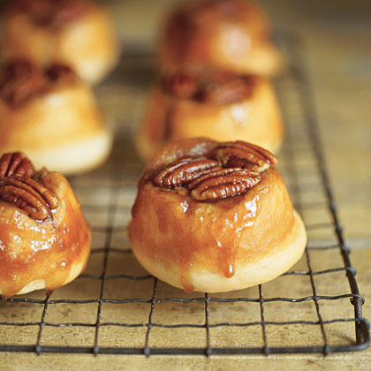 "Pecan Sticky Buns RecipeOoey-gooey sticky buns topped with pecan halves are a fun, festive treat during the holiday season. We've included instructions for ""making it"" (using frozen bread dough) or ""faking it"" (using brown-and-serve rolls)."