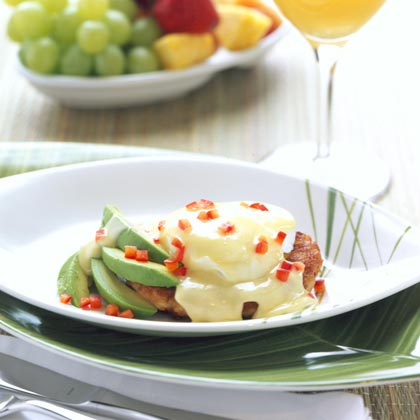 Caribbean Crab Cakes Benedict RecipeInstead of placing the poached egg on top of a slice of ham and an English muffin for a traditional Eggs Benedict, make crab cakes the base. Top with an island-inspired hollandaise sauce spiked with lime juice, ginger and red pepper.