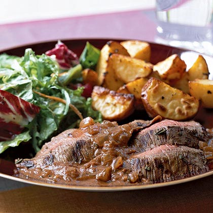 Rosemary-Merlot Flank Steak RecipeMarinate the steak in a mixture of red wine, rosemary, beef broth, and Italian seasoning for only 20 minutes, then combine some of the reserved marinade with Dijon mustard and tomato paste for a savory sauce.