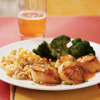 Scallops with Chipotle-Orange Sauce RecipeFresh orange juice and canned chipotle chili in adobo sauce are simmered to form the base of a spunky sweet seafood sauce that's laced with butter. Scallops never tasted so good. Serve over rice or toss with fresh fettuccine or Asian noodles.