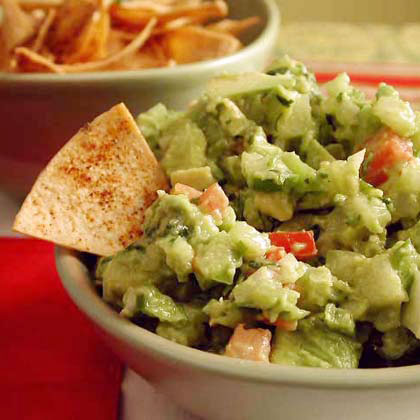Guacamole with Chipotle Tortilla Chips RecipeMaking your own chips gives you the same crunchy flavor without all of the fat of regular tortilla chips. These chipotle–flavored chips highlight the fresh ingredients in the guacamole. Serve guacamole for a creamy dip that is rich in heart-healthy fats.