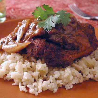 Moroccan Chicken with Almond Couscous RecipeUse standard pantry spices such as cumin, cinnamon and paprika to coat the chicken thighs and keep cleanup easy by cooking the chicken and the sauce in the same skillet.