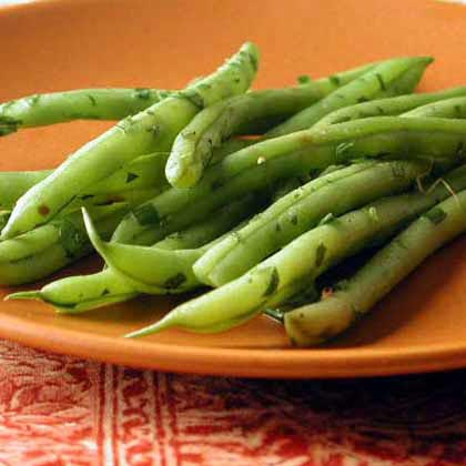 "Chive Green Beans RecipeStone-ground mustard adds an unexpected hint of pungency to simple green beans, something online reviewer Jennifer loved. She added, ""I plan to make this for Thanksgiving."""