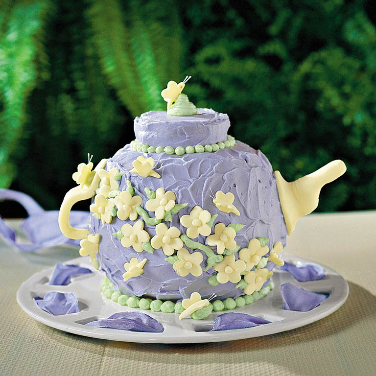"Teapot Cake RecipeBecause nothing says ""Southern Indulgence"" more than a teapot made entirely of cake, food-coloring, and fondant, display this over-the-top dessert as an edible centerpiece. Fondant is a malleable icing, so if you're feeling ambitious, make extra and craft horses for decoration in place of the butterflies."