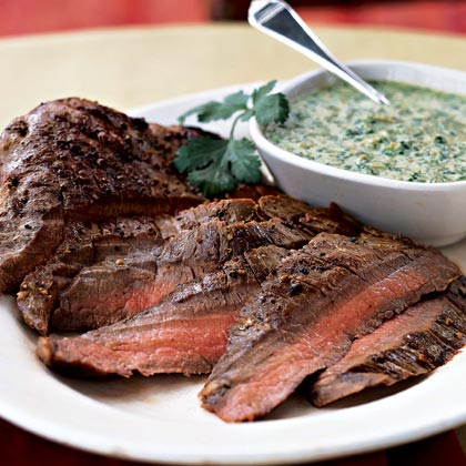 Flank Steak with Cilantro-Almond Pesto RecipeInstead of the usual pine nuts used in pesto, ground almonds thicken this lively herb sauce. The pesto is also good as a spread for burgers and sandwiches, or as a pizza sauce.