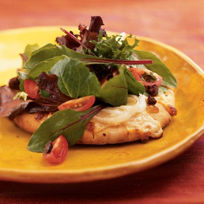 Savor the tastes of Italy by serving individual pita pizzas loaded with fresh vegetables, melted cheese, and a cider vinegar sauce. It's a one-dish meal that's sure to please.Watch the VideoInsalata Pizzas Recipe