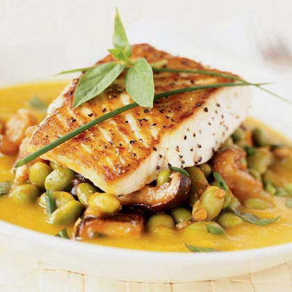Give the exterior of the halibut filets a crispy coating by browning them in a skillet before baking. Serve atop shelled soybeans and a hearty helping of coulis, a thick puréed sauce made from squash, ginger, and curry powder.Recipe: Roasted Fish with Kabocha Coulis