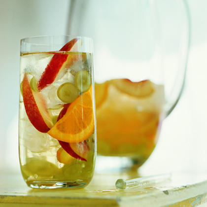 White Sangria RecipeCool down your wedding guests with a refreshing glass of cold, white sangria filled with your favorite fruits. The best part about this drink is that the longer it sits, the sweeter it gets.