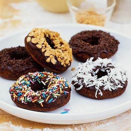 Chocolate Cake Doughnuts RecipeWhat's better than a sugary-sweet doughnut? Just add chocolate. Make a batch of chocolate cake doughnuts even better when you drizzle them with a mocha glaze and top with coconut, chocolate, nuts, or sugary sprinkles.