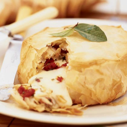 At your next gathering, invite guests to dive into this flaky pastry shell loaded with melted brie cheese, dried tomatoes, pine nuts, and fresh basil. Serve with hearty crackers, ideal for loading on the dense appetizer.Recipe: Filo-wrapped Brie
