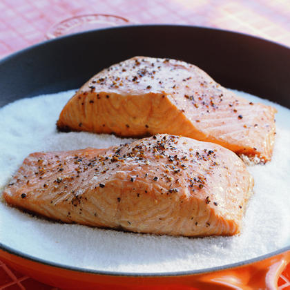 Adding a layer of salt to a skillet provides a high-heat environment and results in a texture that's firm yet moist.Salt-Cooked Salmon Recipe