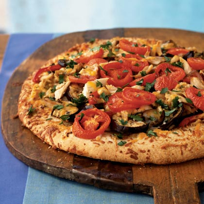 Ratatouille Pizza with Chicken RecipeRatatouille is a popular Provencal dish of eggplant, tomatoes, onions, garlic and herbs simmered in olive oil. Here, it's used as a pizza topping instead of plain tomato sauce. Because it's packed with veggies, the sauce makes this pizza a true one-dish meal.