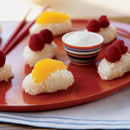 Coconut Frushi RecipeFruit sushi, or frushi, is an Asian-inspired finger food that makes eating fruit fun! Instead of the traditional soy sauce, use honey or melted jelly for dipping. Our kid judges suggested topping this recipe with grapes, peaches, strawberries, or mango.