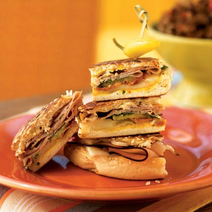 When the chips are gone and the pizza plate is picked clean, bring out these satisfying stackers. Use precooked bacon as a time-saver on the big night to ensure you don't miss a hand. Cook the sandwiches ahead of time, then warm them just before serving or plate them at room temperature.Recipe: Pressed Cubano with Bacon