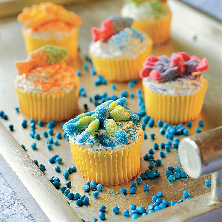 Lemonade Cupcakes RecipePerfect for summer, these cakes get their name–and great flavor–from frozen lemonade concentrate. Balance the tart flavor with a smooth cream cheese frosting. Don't forget the sour gummies on top.